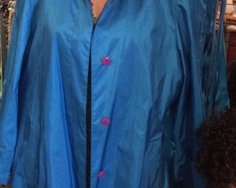 Beautiful turquoise Raincoat size 15-16