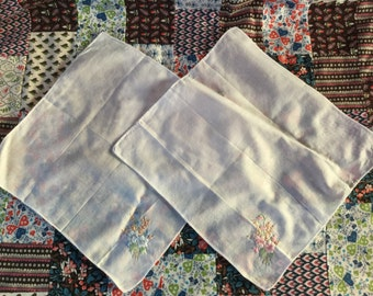 Two hand-stitched handkerchiefs