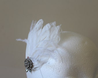 White feathered hair accessory with vintage silver and crystal broach