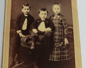 Cabinet Card Photo Three Children Interesting Faces Primitive Setting