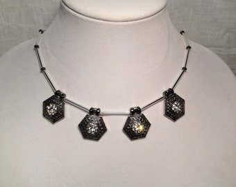 Silver and black necklace with crystal accents