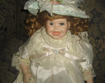 Genuine Porcelain Doll/Laughing China Doll in a Lace Dress