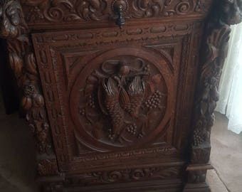 Beautiful Oak Flemish cabinet heavily carved hunting scene