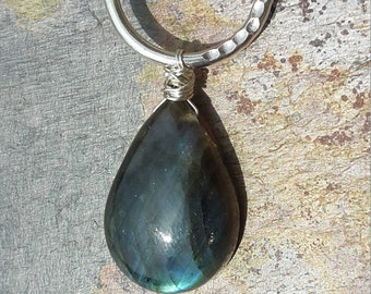 Labradorite pendant necklace, with a Sterling silver textured circle/ring, wire wrapped with Sterling silver, 18 Inch chain hallmarked 925.