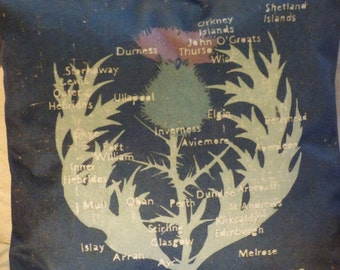 Scottish thistle cushion cover for 45 cm pad.  Velvet cushion front with Scottish place names. Simple navy back with zip at the bottom.