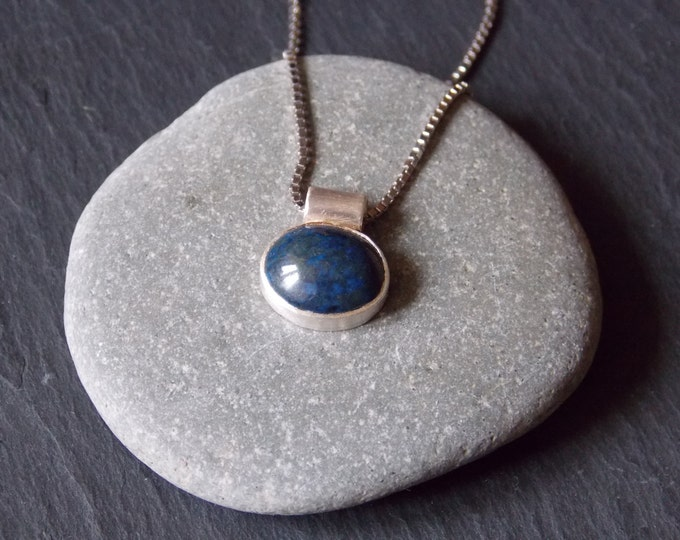 Silver necklace with a oval lapis stone and silver chain.