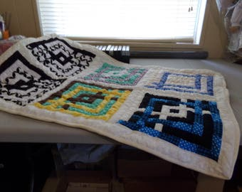 Multi color lap quilt, hand quilted