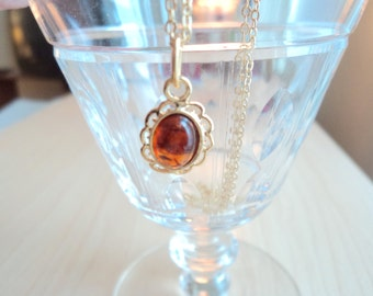 Amber necklace. Vintage pendant with gold. Amber gemstone.