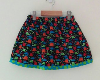 size 4 dinosaur skirt with elasticised waist and contrast trim and internal pockets