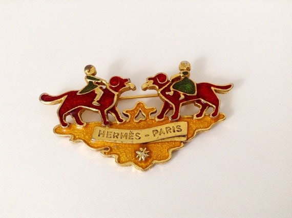 Authentic Hermes brooch, enamel in gold plated metal base, main tone orange and red