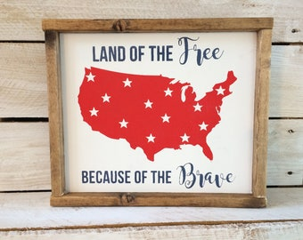 Land of the Free Because of the brave wood sign
