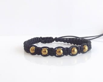 Delicate macrame bracelet of bracelet with gold-colored Hematite beads adjustable