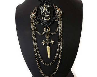 Chic black and bronze Gothic Necklace: skeleton, skull, dagger is hand - Gothic jewelry - gift idea for woman - OOAK - Gothic.