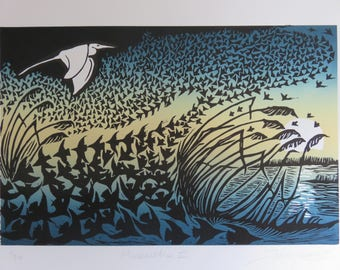 Murmuration III: lino cut print of a flock of starlings and an egret flying against the setting sun.