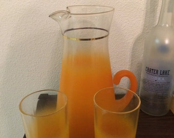 Blendo pitcher and two tumblers orange frost MidCentury