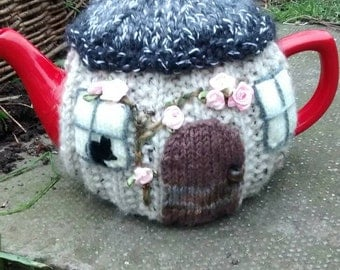Hand-knitted Woodland Cottage tea cosy