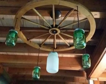 wagon wheel chandelier with mason jar fixtures alternating length wagon wheel mason jar