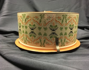 Vintage tin cake carrier, orange, cream, green and brown, ornate design, Ballonoff Cleveland, handle on top