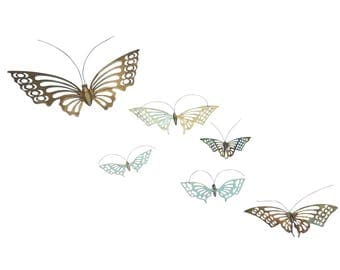 A vintage kaleidoscope of brass butterfly wall hanging décor (set of six)