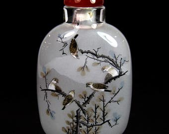 A delicately painted Chinese inside painted glass snuff bottle, with agate stopper, H. 9cm.
