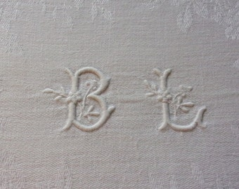 A tablecloth, damask, with pretty silky patterns, monogrammed BL