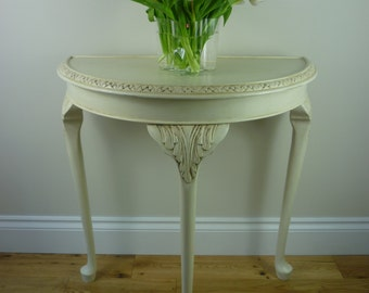 Éleonore ... vintage  demi lune  console  table with decorative carving.