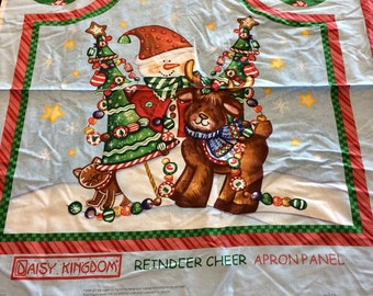 One panel cotton fabric to sew your own Christmas snowman apron and hot pad.