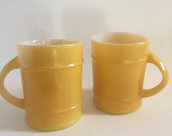 Pair of yellow Fire King barrel mugs