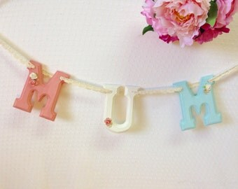 Wooden letter 'MUM' bunting/garland, perfect for Mother's Day!