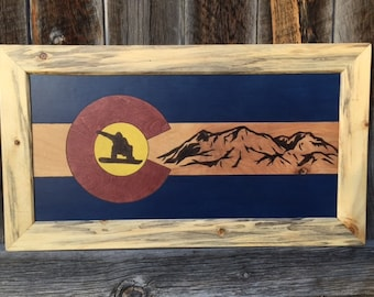 Colorado Flag Snowboarder Mountains background