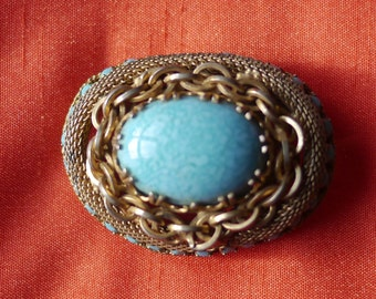 Gold tone faux turquoise, mesh and chain vintage brooch
