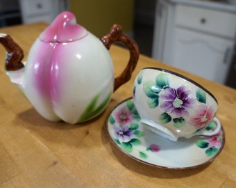 Teapot shaped like a Peach Fruit and Hand-painted Nippon tea cup and saucer purple pink flowers
