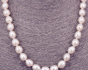 String of pearls oval 10mm chain with Pearl PKE106