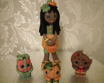 Shopkins Inspired Dolly and Three Figures.  Clay.  Non-edible.
