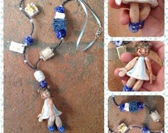 """Collana in ceramica con bambolina:"""" la Cartolaia""""/ Clay with little doll """"the Stationer."""""""