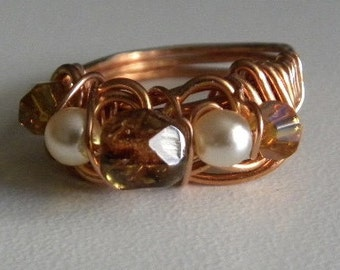 Gold crystals and white pearl wire wrapped ring.