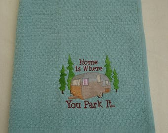 Tea towel, embroidered with: Home is where you park it. For caravan lovers!