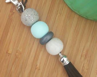 Mint and grey polymer clay keyring with black tassel. Keychain zipper charm.