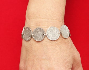 Bracelet of coins. Coins Austria. Coins with the eagle.