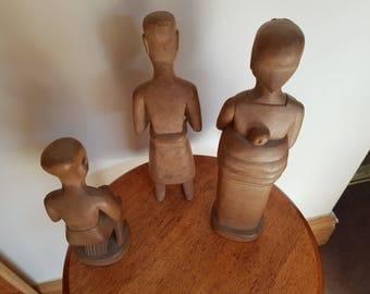 3 oriental figures in pale wood