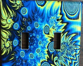Swirling blue flames switchplate