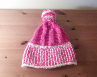 Baby bobble hat in raspberry and white