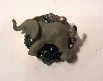 mini pins, elephant, sheep, man with Hat