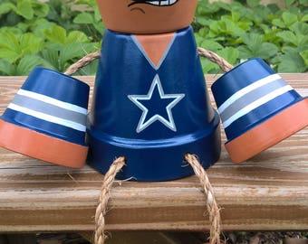 Cowboys clay pot boy