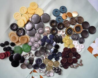 Many different buttons. Vintage wooden buttons, metal buttons, plastik buttons. fabric buttons.