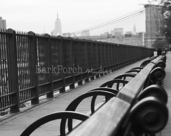 Take a seat: Row of park benches, with New York City skyline; Black and white; NYC; Brooklyn Bridge; Wall Art; bedroom; bathroom; kitchen