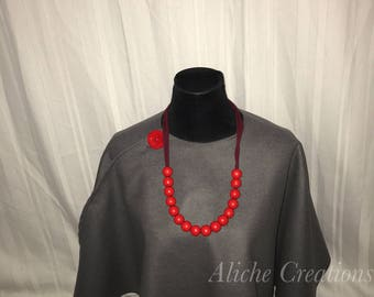Grey cape with red button