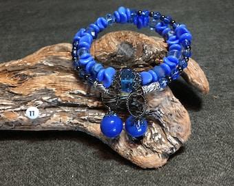 Large Blue Memory Wire Bracelet with 2 Blue Vintage Marbles