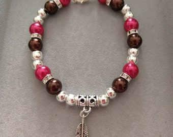 Brown and Red Glass Pearl Feather Charm bracelet