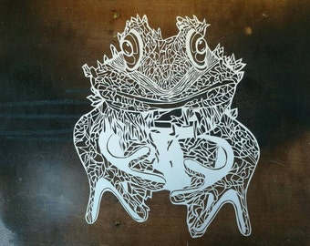 Hand made papercut of frog...